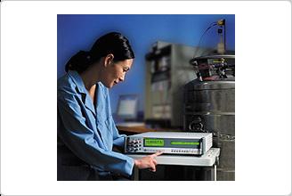 Technician Using a Fluke 8508A 8.5 Digit Reference Multimeter